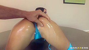 Oiled chick with awesome butt gets fingered really hard