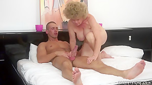 Handsome younger stud fucks hairy old pussy