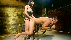 Bobbi Starr pounding a guy in the ass