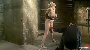 Katie Kox and her Monster tits are introduced to Hogtied the meet and greet.