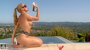Fascinating blondie is stripping near pool